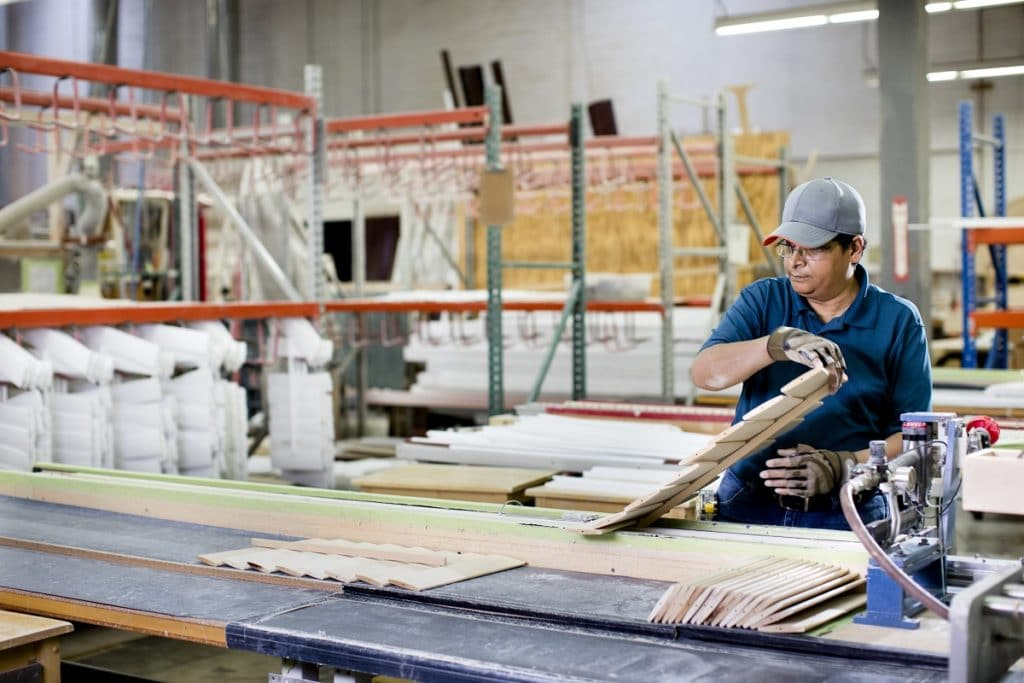 man working in blinds factory