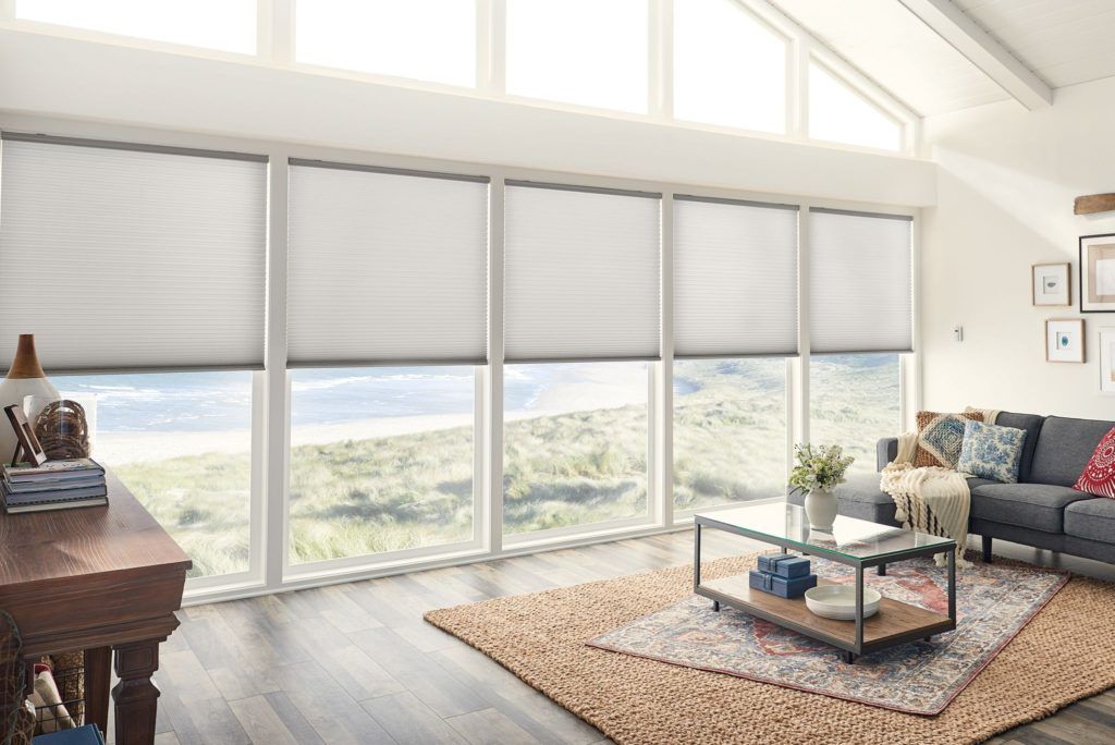 Sunny living room with lare window and roller blinds